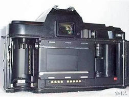 Either of minolta s program backs can be attached cordlessly in place